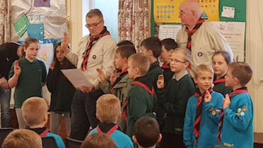 Beavers making scout promise in scout hall