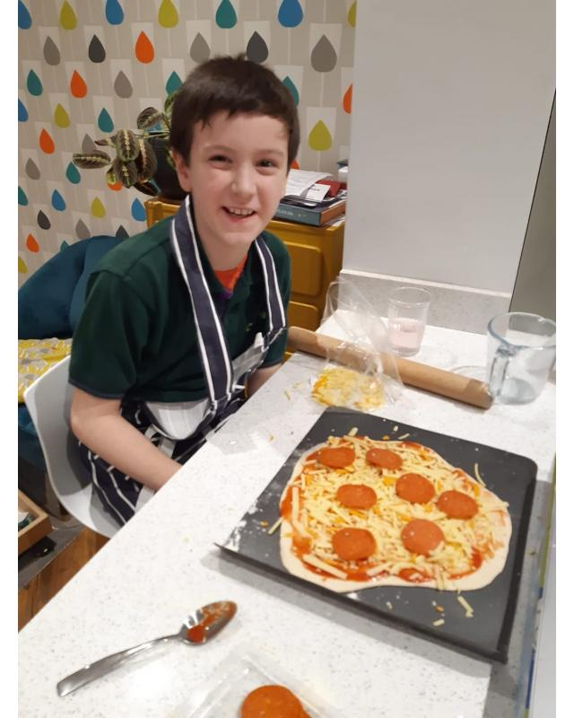 Cub at table with his pizza