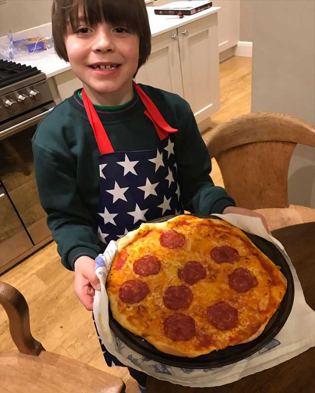 cubs cooking pizza big smile