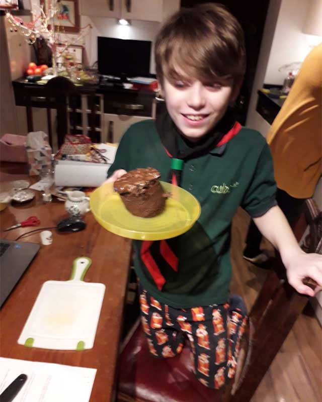 cubs holding cake on a plate