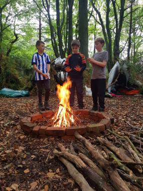 Scouts warming by the fire