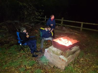 Scouts cooking on open fire